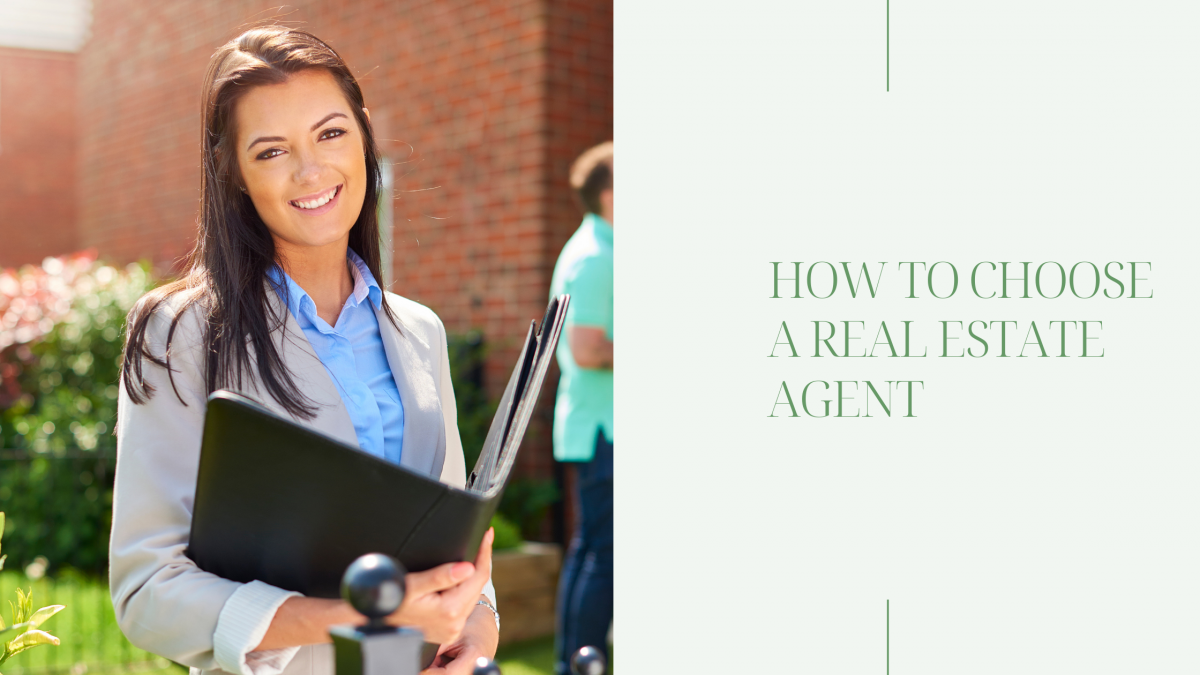 real estate agent smiling and holding a folder